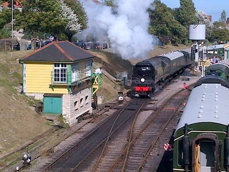 Steam locomotive pulls out of swanage station